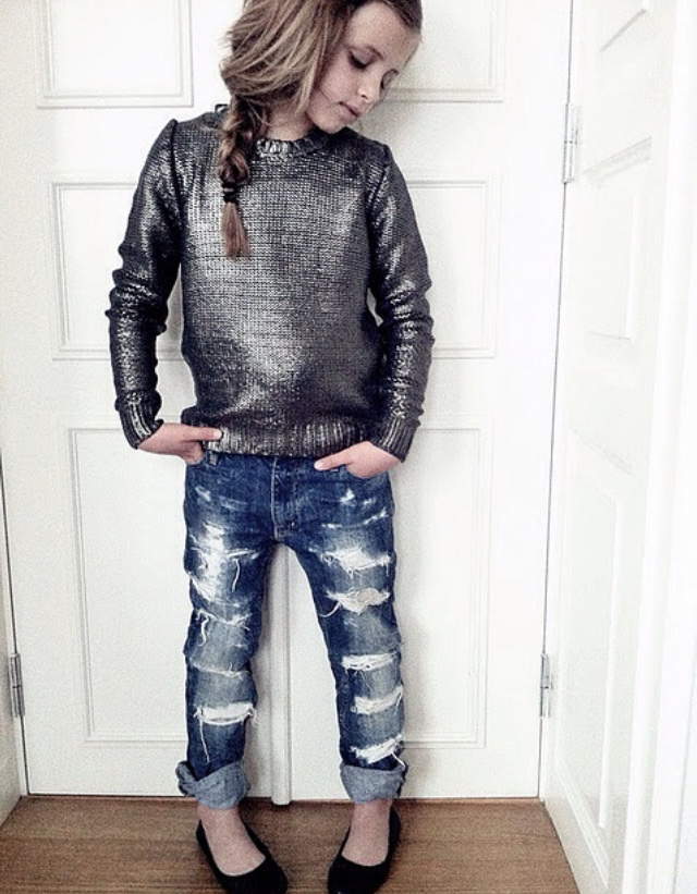 little girl in ripped jeans